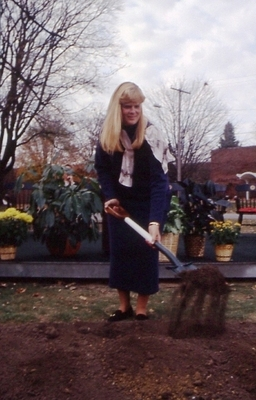 Sheean Library Director Sue Stroyan breaking ground at new library site.