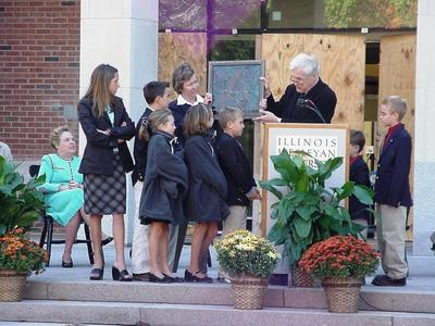 Glass panel is presented to Ames' grandchildren at Dedication.