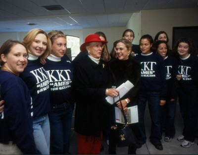 Joyce Eichhorn Ames, '49, poses with members of Kappa Kappa Gamma.