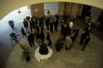 Speical guests gather in the rotunda after the dedication ceremony to await the building tour.