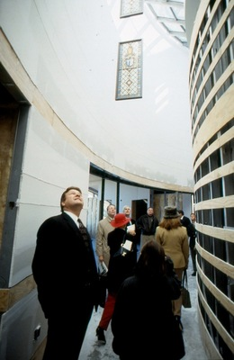 Dedication tour guests view the fourth floor.