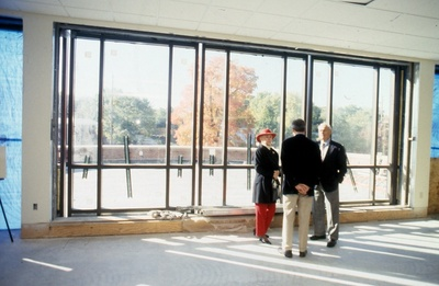 Mr. and Mrs. Ames view the new library patio.