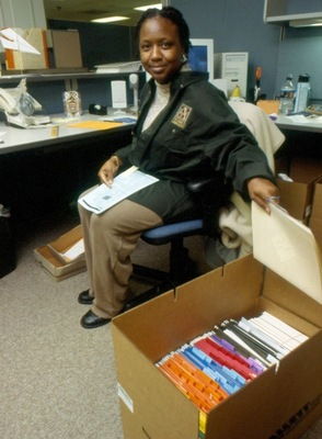 Library staff pack in preparation for move.