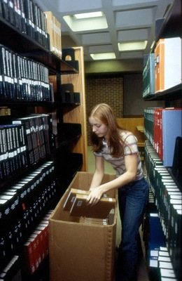 Journals are removed from shelves in Sheean Library.