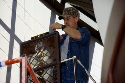 An installer checks the suspension line for one of the Pembroke Windows.