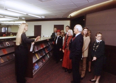 Library Director Sue Stroyan leads a tour of the entry level.