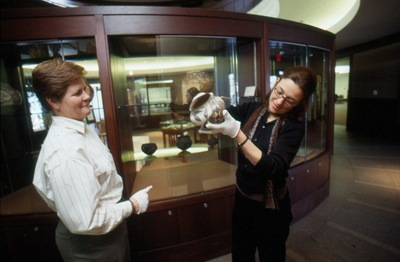 Archivists inspect the pottery.