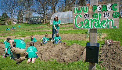 IWU faculty and students work with local preschoolers in the IWU Peace Garden.